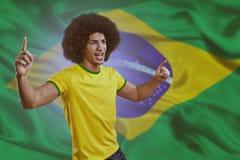Jugador de fútbol con la bola Imagen de archivo libre de regalías