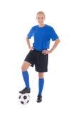 Jugador de fútbol de sexo femenino en uniforme del azul con la bola aislada en blanco Imagenes de archivo