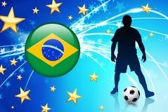 Jugador de fútbol del Brasil en fondo ligero abstracto Fotos de archivo libres de regalías