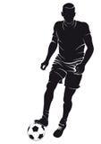 Jugador de fútbol del fútbol con la bola Imagen de archivo