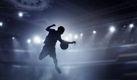 Jugador de fútbol en la acción Técnicas mixtas Imagenes de archivo