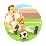 Jugador de fútbol herido Imágenes de archivo libres de regalías