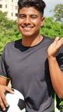 Jugador de fútbol de sexo masculino y felicidad foto de archivo