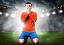 Jugador de fútbol triste Imagen de archivo