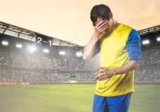 Jugador de fútbol triste Imagen de archivo libre de regalías