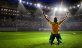 Jugador de fútbol victorioso fotografía de archivo libre de regalías
