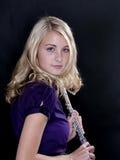 Jugador de flauta adolescente en negro Imágenes de archivo libres de regalías