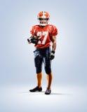 Jugador de fútbol americano en blanco de la acción aislado Fotos de archivo