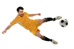 Jugador de fútbol que golpea la bola con el pie Imagen de archivo libre de regalías
