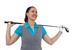 Jugador de golf que celebra un club de golf y una pelota de golf Fotos de archivo libres de regalías