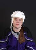 Jugador de hockey masculino adolescente Fotos de archivo