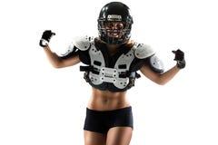 Jugador de la mujer del fútbol americano en la acción Fotos de archivo libres de regalías