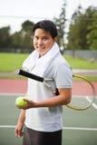 Jugador de tenis asiático joven Fotografía de archivo