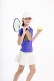 Jugador de tenis bonito de la muchacha en el backgroud blanco en estudio Fotos de archivo