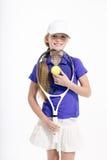 Jugador de tenis bonito de la muchacha en el backgroud blanco en estudio Imagen de archivo