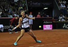 Jugador de tenis de la mujer en la acción Imagen de archivo libre de regalías