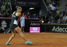 Jugador de tenis de la mujer en la acción Imágenes de archivo libres de regalías