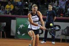 Jugador de tenis de la mujer en la acción Imagenes de archivo