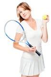 Jugador de tenis de la mujer joven con la estafa en blanco foto de archivo
