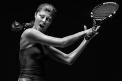Jugador de tenis en la acción Fotografía de archivo libre de regalías