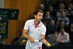 Jugador de tenis Federico Nielsen en la acción en un partido de la Copa Davis Foto de archivo libre de regalías