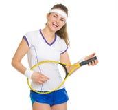 Jugador de tenis feliz que juega en la estafa como en la guitarra Foto de archivo