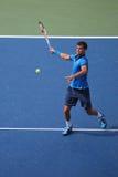 Jugador de tenis profesional Grigor Dimitrov de Bulgaria durante el partido redondo 4 del US Open 2014 Imagen de archivo libre de regalías