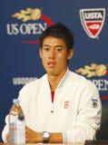 Jugador de tenis profesional Kei Nishikori durante rueda de prensa después de que él ganara el partido de semifinal en el US Open Imagen de archivo libre de regalías