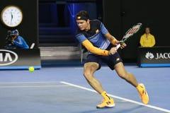 Jugador de tenis profesional Milos Raonic de Canadá en la acción durante su partido 2016 de semifinal de Abierto de Australia Fotografía de archivo