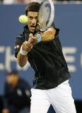 Jugador de tenis profesional Novak Djokovic durante partido del cuarto de final en el US Open 2013 contra Mikhail Youzhny Imágenes de archivo libres de regalías