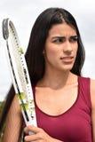 Jugador de tenis de sexo femenino atlético bajo tensión Imágenes de archivo libres de regalías