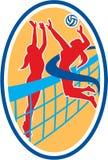 Jugador de voleibol que clava la bola que bloquea óvalo Foto de archivo libre de regalías