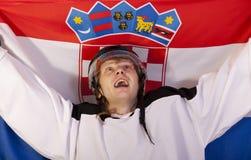 Jugador del hockey sobre hielo con el indicador croata Foto de archivo