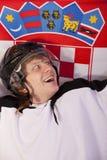 Jugador del hockey sobre hielo con el indicador croata Imagenes de archivo