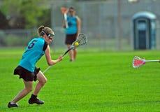 Jugador del lacrosse de las mujeres Imagen de archivo libre de regalías