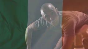 Jugador del rugbi que hace un paso con una bandera irlandesa en el primero plano libre illustration