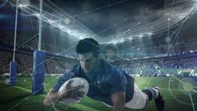 Jugador del rugbi que se zambulle para anotar en un estadio grande con las conexiones ligeras en el primero plano libre illustration