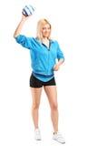 Jugador femenino profesional del balonmano que celebra una bola Fotografía de archivo