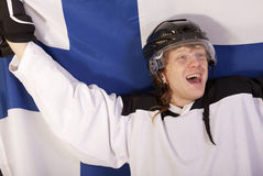 Jugador finlandés feliz del hockey sobre hielo Imagen de archivo