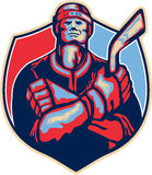 Jugador Front With Stick Retro del hockey sobre hielo Imagenes de archivo