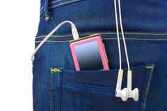Jugador MP3 en bolsillo de los pantalones vaqueros Imágenes de archivo libres de regalías