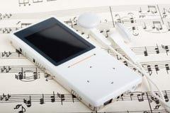 Jugador MP3 y nota fotos de archivo libres de regalías