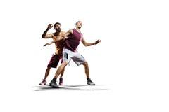 Jugadores de básquet en la acción aislados en blanco Imagen de archivo
