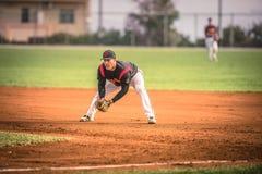 Jugadores de béisbol durante una acción Imagenes de archivo