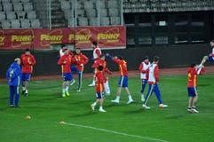 Jugadores de equipo nacional españoles del fútbol durante el calentamiento Foto de archivo