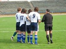 Jugadores de fútbol foto de archivo