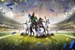 Jugadores de fútbol adultos del collage en la acción en panorama del estadio Imagen de archivo libre de regalías