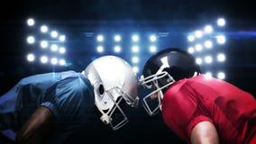 Jugadores de fútbol americano contra luces que destellan almacen de metraje de vídeo