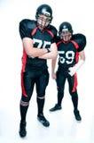 Jugadores de fútbol americano en uniforme Imagen de archivo