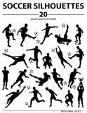 Jugadores de fútbol de las siluetas Foto de archivo